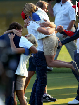 Phil Mickelson and Keegan Bradley celebrate on the 17th green with Amy Mickelson and Jillian Stacey after defeating Rory McIlroy and Graeme McDowell 2 and 1 during the afternoon four-ball matches on Friday.