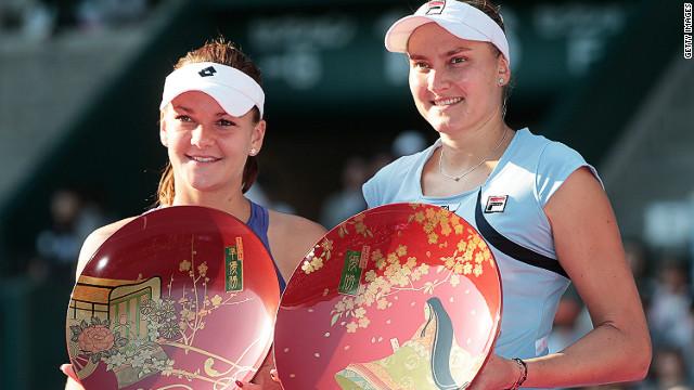 Nadia Petrova (right) upset Poland's Agnieszka Radwanska in the final of the Pan Pacific Open in Tokyo on Saturday.