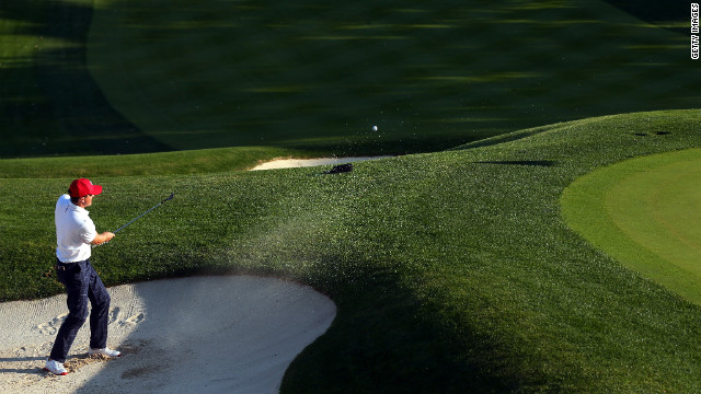 Keegan Bradley of the USA hits out of the bunker on the 16th green after defeating Rory McIlroy and Graeme McDowell on Friday, September 28.