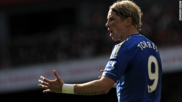 Fernando Torres celebrates scoring the opening goal for Cheslea in a 2-1 over Arsenal at the Emirates Stadium on Saturday.