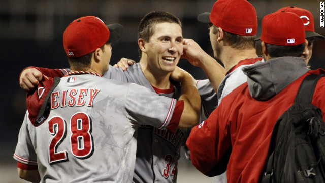 Teammates congratulate Homer Bailey (without cap) after his no-hitter Friday night in Pittsburgh.
