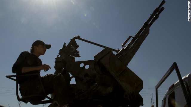 A Syrian rebel mans a machine gun near Al-Bab, northeast of Syria's second city Aleppo.