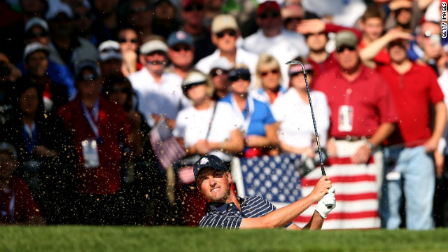 Webb Simpson of the United States plays a bunker shot on Saturday.