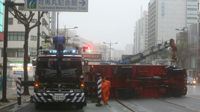 Effects of typhoon Jelawat overturn a vehicle in Naha City, Okinawa prefecture.