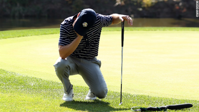 Zach Johnson of American team reacts to a putt on the 12th hole on Saturday.