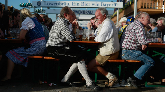 People enjoy themselves as they drink beer outside the Lowenbrau beer tent.
