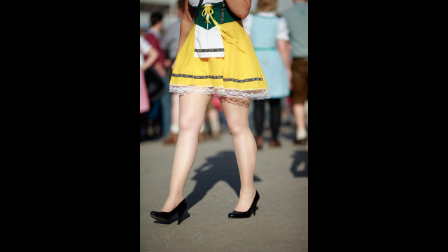 A woman dressed in traditional Bavarian clothing attends day seven of Oktoberfest on Friday.