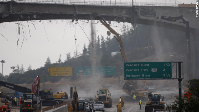 Workers demolish the south side of Mulholland overpass on the 405 freeway during last year's