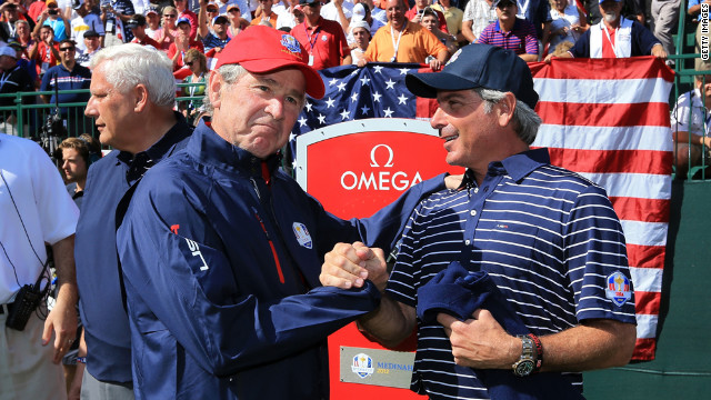 Former U.S. President George W. Bush shakes hands with Fred Couples, assistant captain of Team USA on Saturday, September 29.