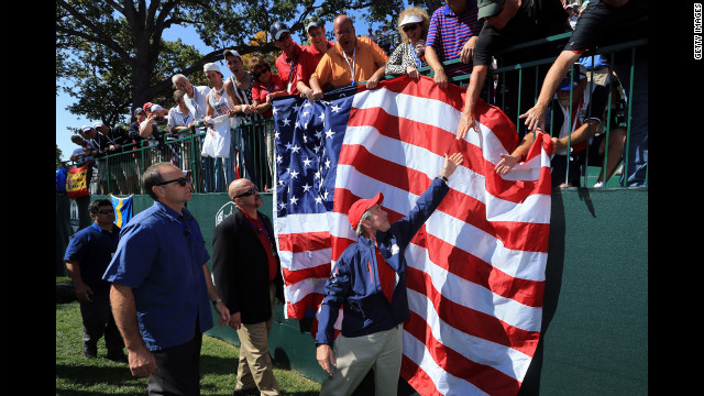 Bush reaches to shake the hands of spectators at the tournament Saturday.