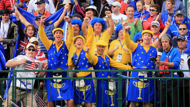 European fans cheer at the start of the final day of play at the 39th Ryder Cup on Sunday.