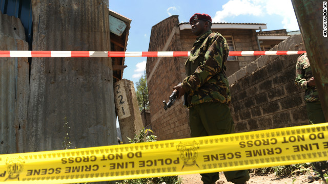 A policeman stands guard next to the scene where a blast ripped through a church in Nairobi on September 30, 2012.