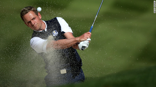 Luke Donald of Europe plays a bunker shot on the fifth hole on Sunday.