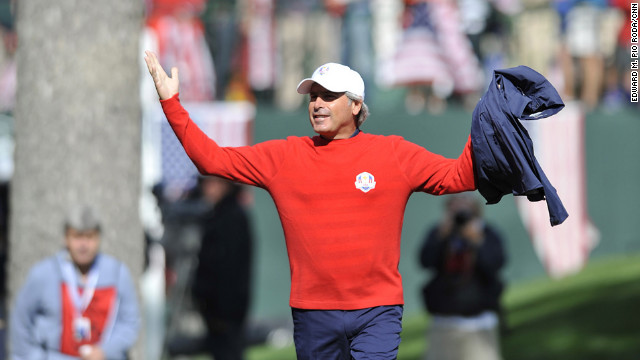 Team USA Assistant Captain Fred Couples stirs up the crowd during play Sunday.
