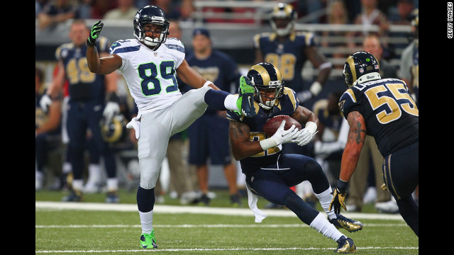 Trumaine Johnson of the St. Louis Rams intercepts a pass intended for Doug Baldwin of the Seattle Seahawks on Sunday.