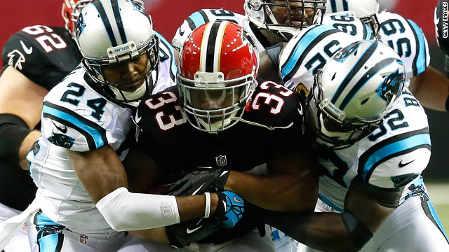 Michael Turner of the Atlanta Falcons is tackled during Sunday's game against the Carolina Panthers at the Georgia Dome in Atlanta.