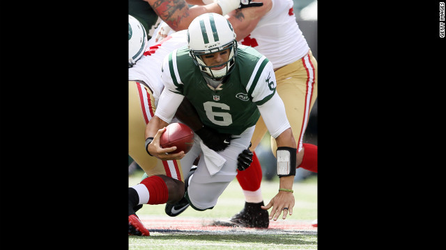 Quarterback Mark Sanchez of the New York Jets is sacked in the first quarter against the San Francisco 49ers on Sunday.