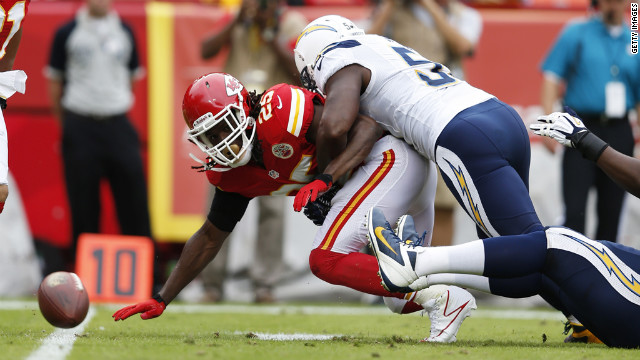 Takeo Spikes of the San Diego Chargers forces a fumble by Jamaal Charles of the Kansas City Chiefs on Sunday.