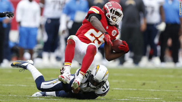Jamaal Charles of the Kansas City Chiefs gets tackled by Eric Weddle of the San Diego Chargers on Sunday.
