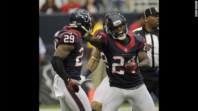 Johnathan Joseph of the Houston Texans, right, celebrates with teammate Glover Quin after Quin sacked Tennessee Titans quarterback Jake Locker on Sunday.
