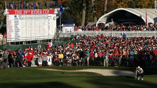Martin Kaymer sets up the final putt on the 18th green.