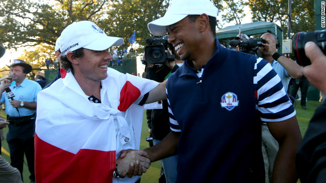 Rory McIlroy of Europe greets Tiger Woods on the 18th green after Europe defeated the United States 14.5 to 13.5 to retain the Ryder Cup.