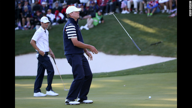 Steve Stricker of the United States reacts to a missed putt on the 17th green as Martin Kaymer of Europe looks on during Sunday's competition.