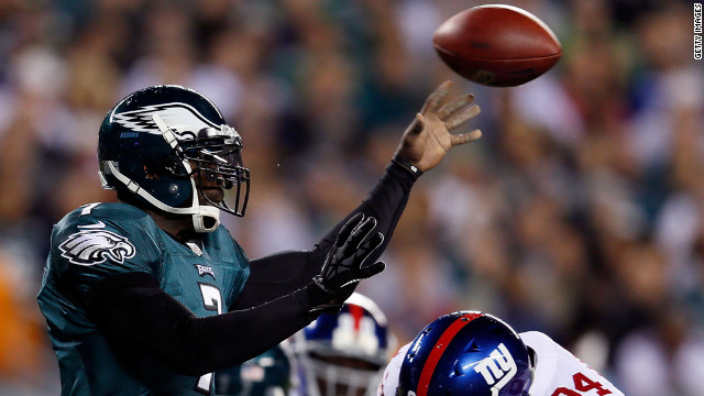 Eagles quarterback Michael Vick is tackled by Giants linebacker Mathias Kiwanuka on Sunday. 