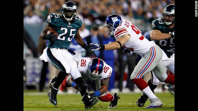 LeSean McCoy of the Philadelphia Eagles is tackled by No. 26 Antrel Rolle and No. 93 Chase Blackburn of the New York Giants on Sunday.