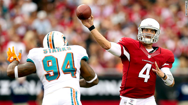 Arizona Cardinals quarterback Kevin Kolb throws a pass over Randy Starks of the Miami Dolphins on Sunday at the University of Phoenix Stadium in Glendale, Arizona.