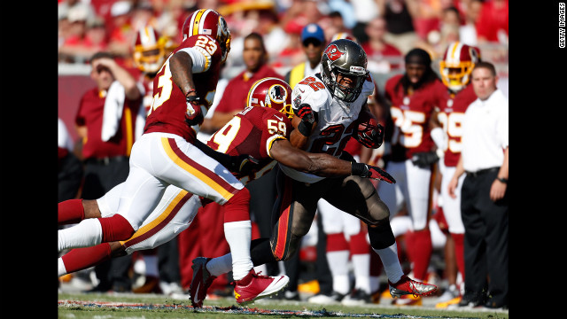 Doug Martin of the Tampa Bay Buccaneers is tackled Sunday by London Fletcher of the Washington Redskins.