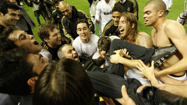 Real Madrid's players toss Mourinho into the sky after clinching the 2012 La Liga title following their victory at Athletic Bilbao. The achievement means he has won league titles in Portugal, England, Italy and Spain.