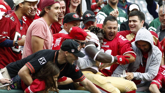 Anthony Dixon of the San Francisco 49ers celebrates with fans after a win over the New York Jets on Sunday.