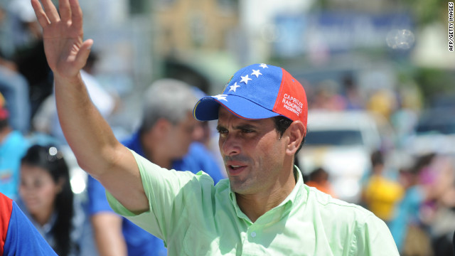 Venezuelan opposition presidential candidate Henrique Capriles Radonski waves to supporters during a campaign rally in September.