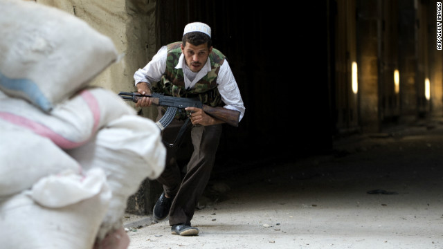 A Syrian rebel ducks for cover during clashes to control the area around the Zacharias mosque in the old city of Aleppo.