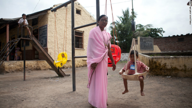 Sai is weighed by an anganwadi worker. She weighs 10.3 kilograms, almost two kilgrams less than she should for her age and height.