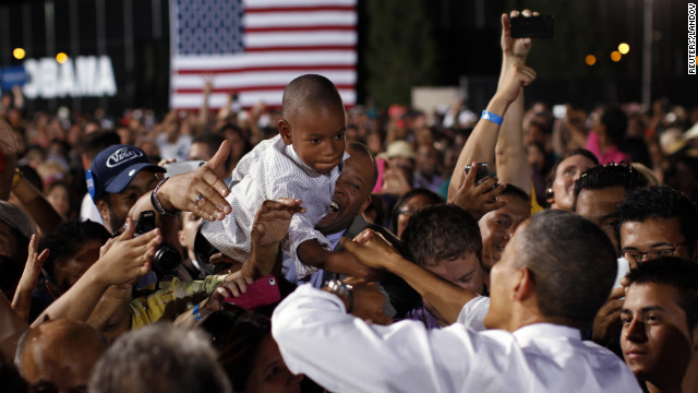 A boy reaches out to shake hands with Obama on Sunday in Las Vegas. The president was in Nevada ahead of Wednesday's presidential debate in Denver.