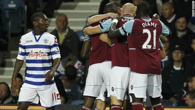 West Ham's Ricardo Vaz Te is mobbed by his teammates after scoring their second against Queen's Park Rangers
