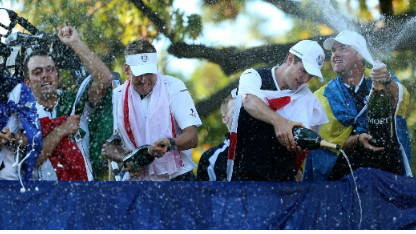 Francesco Molinari, Ian Poulter and Nicolas Colsaerts of Europe celebrate after winning The 39th Ryder Cup at Medinah Country Club on September 30, 2012 in Medinah, Illinois.