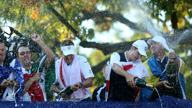 Francesco Molinari, Ian Poulter and Nicolas Colsaerts of Europe celebrate after winning the 39th Ryder Cup at Medinah Country Club in 2012 following a dramatic 14½ - 13½ victory.