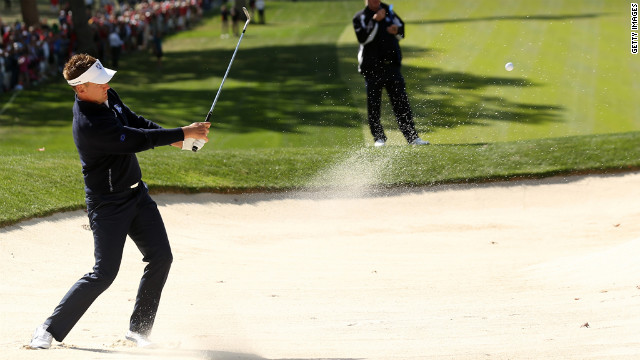Ian Poulter of Europe plays a bunker shot Sunday on the fourth hole.