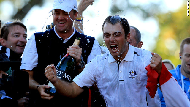 Peter Hanson, center, and Francesco Molinari of Europe celebrate their team winning the 39th Ryder Cup on Sunday, September 30, in Medinah, Illinois. Europe produced the greatest comeback in Ryder Cup history to defeat the United States and retain the trophy. <strong><a href='http://www.cnn.com/SPECIALS/world/photography/index.html'>See more of the best of CNN's photography.</a></strong>