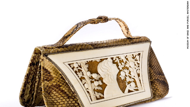 This German-designed snakeskin handbag from the 1920s features an ivory &quot;cover sheet&quot; depicting the biblical Eve with the proverbial apple. 