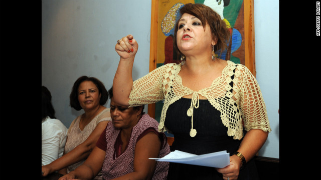 Tunisian university professor and human rights defender Raja Ben Slama speaks Saturday in Tunis during a meeting of support for the woman standing trial.
