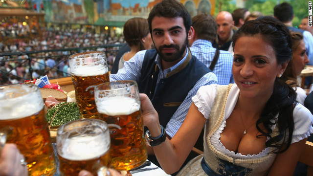Grigoris Makos of the football team TSV 1860 Munich and his wife, Athena, enjoy some suds Tuesday.