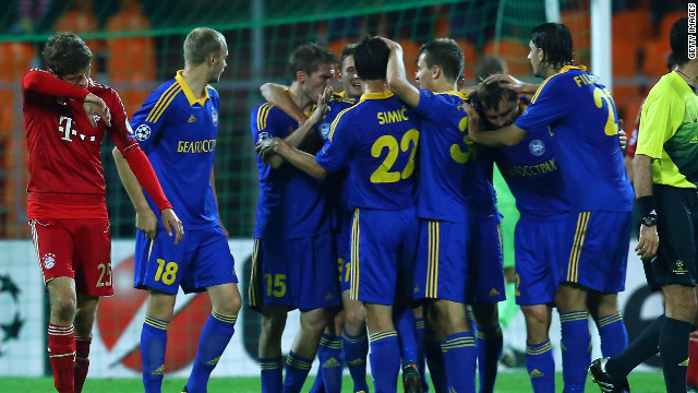 Bate Borisov players celebrate on their way to a 3-1 win over Bayern Munich in their Champions League group match.