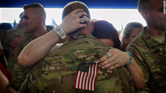 Back from Afghanistan, troops from the Indiana Army National Guard are greeted by family and friends on September 26.