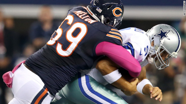 Henry Melton of the Bears sacks quarterback Tony Romo of the Cowboys in the first quarter on Monday.