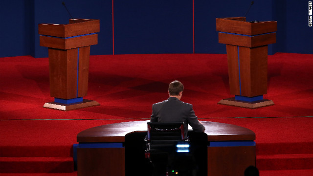 University of Denver student Sam Garry sits at the moderator's desk before a presidential debate dress rehearsal at the University of Denver on Tuesday, October 2.