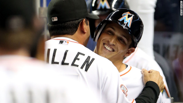 Adam Greenberg hugs Miami Marlins manager Ozzie Guillen after his at-bat Tuesday night against the New York Mets.